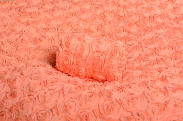 Stoff mit Blumen in Lachsfarbe