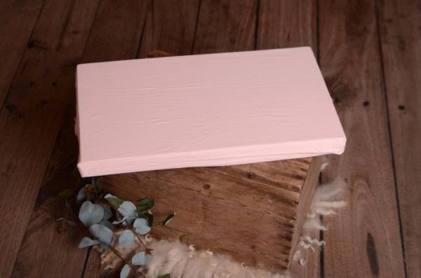 Colchón con funda rosa bebé